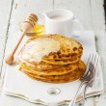 Pancakes with honey — Stock Photo