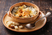 Onion soup with croutons — Stock Photo