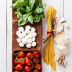 Italian flag colors with Green basil, white mozzarella, red toma — Stock Photo #43041753