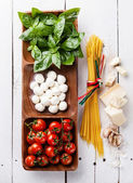 Italian flag colors with Green basil, white mozzarella, red toma — Stock Photo
