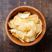 Crispy potato chips on wooden background — Stok fotoğraf