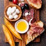 Prosciutto ham, melon cantaloupe and Mozzarella — Stock Photo #48457039