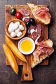 Prosciutto ham, melon cantaloupe and Mozzarella — Stock Photo