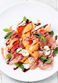Melon and prosciutto ham salad with Mozzarella — Stock Photo