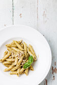 Pasta Penne with pesto sauce — Stock Photo