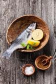 Fresh raw fish seabass with salt — Stock Photo
