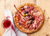 Cold meat plate and wine — Stock Photo