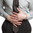 Businessman with stomach ache — Stock Photo
