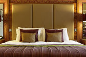 Luxurious hotel bed — Stock Photo