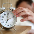 Stock Photo: Turning off alarm clock