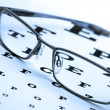 Glasses and eyechart - Stock Photo