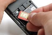 Inserting a sim card — Stock Photo