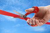 Cutting a red ribbon — Stock Photo