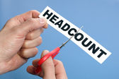 Cutting the headcount — Stock Photo