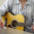 Song writing with acoustic guitar — Stock Photo