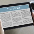 Stock Photo: Digital tablet showing news