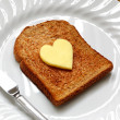 Royalty-Free Stock Photo: Heart shaped butter on toast