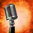 Stock Photo: Vintage microphone on grunge background