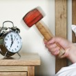 Alarm clock and sledgehammer — Stock Photo #24529349