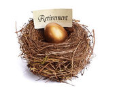 Retirement savings golden nest egg — Zdjęcie stockowe