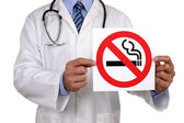 Doctor with no smoking sign — Stock Photo