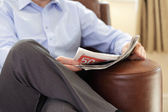 Reading a newspaper — Stock Photo