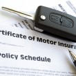 Stock Photo: Motor insurance certificate with car key