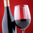 Stock Photo: Bottle and glass of red wine