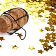 Confetti and champagne cork — Stock Photo