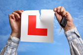Tearing up L plate after passing driving test — Stock Photo