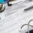 Stock Photo: Cardiogram and stethoscope