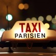 Stock Photo: Paris taxi by the Arc de Triomphe