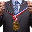 Stock Photo: Awarding gold medal