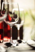 Wine glass and place settings — Stock Photo