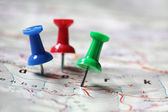 Travel destination mstked with pushpins — Stock Photo
