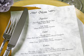 Menu and cutlery on restaurant table — Stock Photo