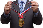 Awarding gold medal — Stock Photo