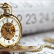 Gold pocket watch and calendar — Stock Photo #31681703