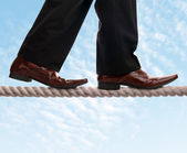 Tightrope walker businessman — Stock Photo