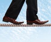 Tightrope walker businessman — Stock Photo