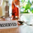 Restaurant reserved table sign — Stock Photo