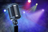 Vintage microphone on stage — Stock Photo