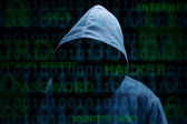 Hooded silhouette of a hacker — Stock Photo