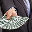 Holding one hundred dollar bills — Stock Photo