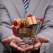 Shopping cart with gift box — Stock Photo #38032237