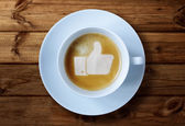 Thumbs up sign in coffee — Stock Photo