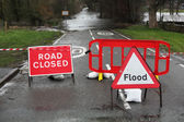 Road closed and flood sign — Stock Photo