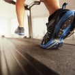 Man running on treadmill — Stock Photo #44080663
