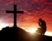 Man praying to a cross — Stock Photo
