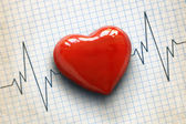 Cardiogram and heart — Stock Photo